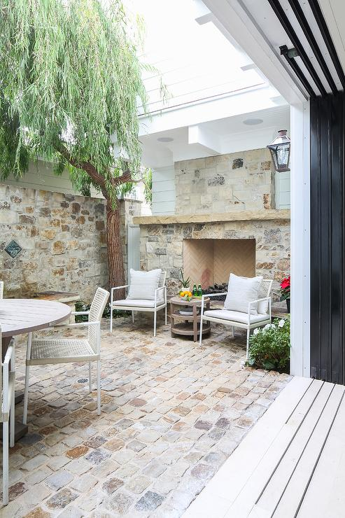 white rattan outdoor chairs at brick