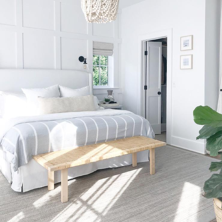 White Wingback Bed On Gray Jute Rug