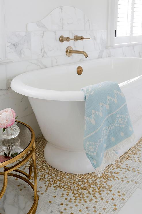 Roll Top Bathtub On White And Gold Mosaic Floor Tiles
