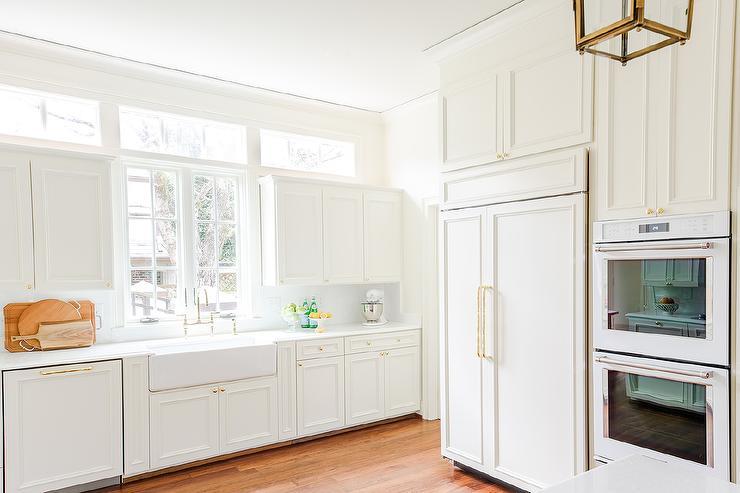 Off White Wood Panel French Door Refrigerator With Brass Door