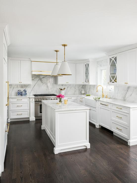 White And Gold Kitchen With Dark Stained Oak Wood Floors