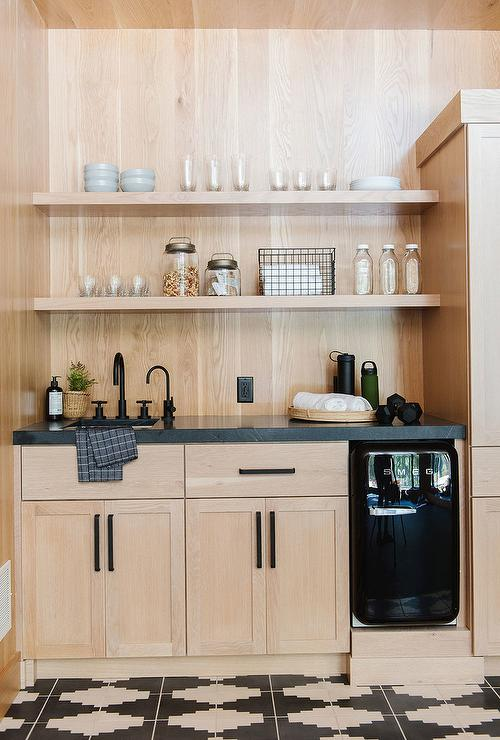 Light Oak Pantry Cabinets With Honed Black Marble Transitional Kitchen