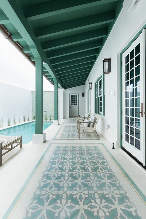 Cottage Patio With In Ground Pool And Wicker Loungers