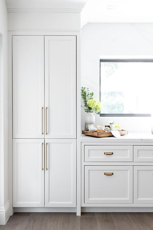Light Gray Kitchen Cabinets with Thin Long Brass Pulls ...