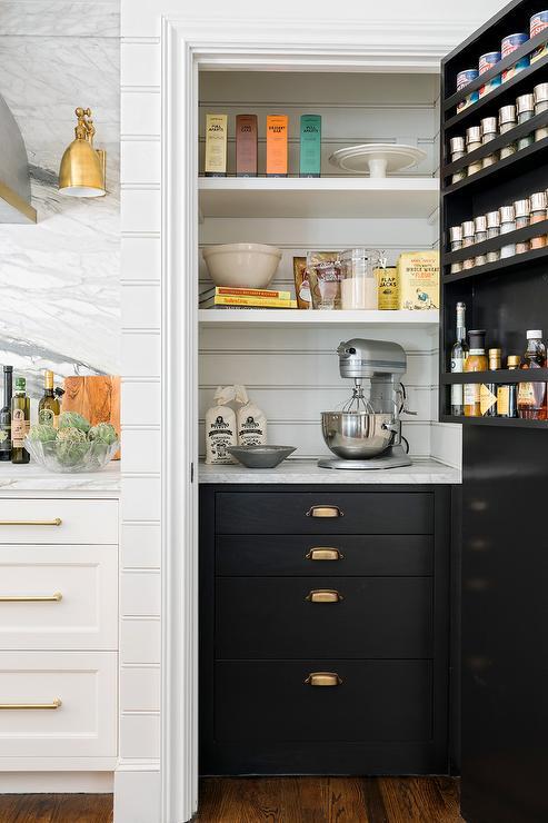 Glossy Black Pantry Door With Brass Door Knob