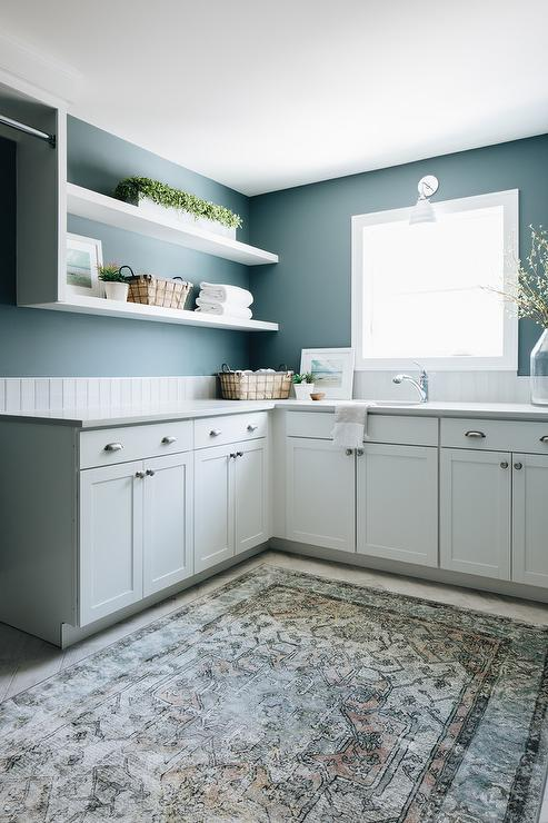 White And Blue Laundry Room With White Shelves