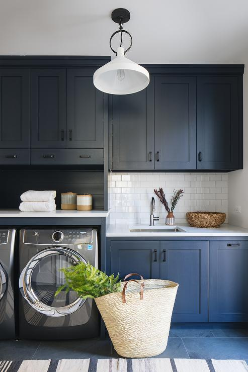 Dark Blue Flat Front Laundry Cabinets With Brass Hardware
