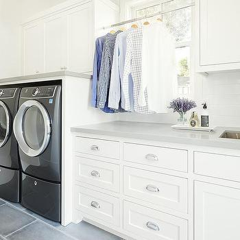 Laundry Room Clothes Rod In Front Of Window Design Ideas