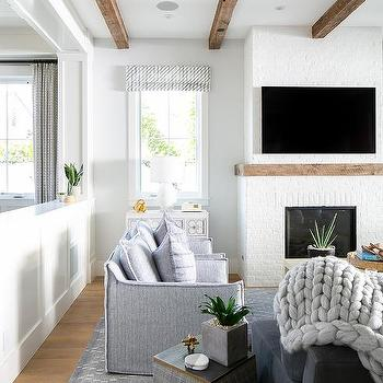 Gray Accent Chairs With White Brick Fireplace