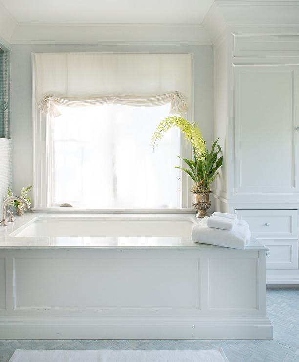 privacy for bathroom window over tub decorative window.htm wainscoted bathtub under windows transitional bathroom  wainscoted bathtub under windows