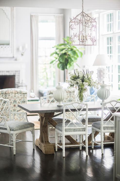 White Bamboo Chairs At Zinc Top Dining Table Transitional Dining Room