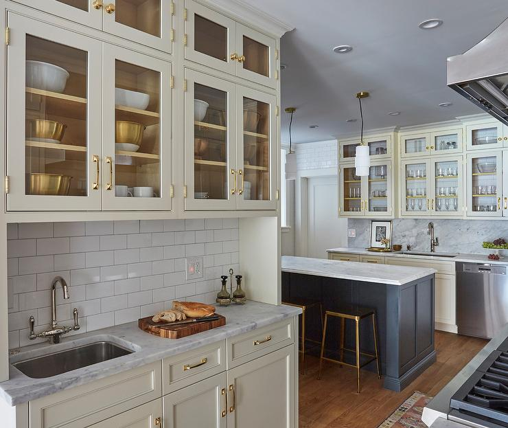 Tan Cabinets With White Subway Tiles Transitional Kitchen