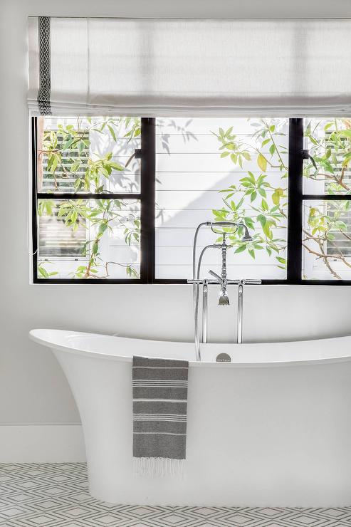 privacy for bathroom window over tub decorative window.htm freestanding bathtub on white and gray diamond pattern tiles  white and gray diamond pattern tiles