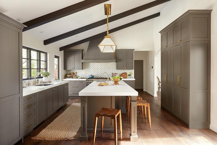 Gray Kitchen Under Wooden Beams On Sloped Ceiling Transitional Kitchen