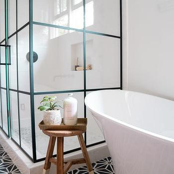 Oval Bathtub With Branches In Vase Transitional Bathroom