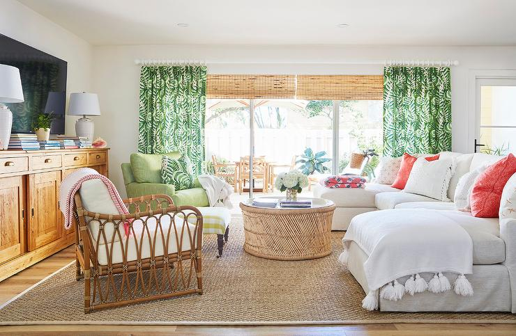 Elegant Bamboo Roman Shades Layered Behind Green Print Curtains Hang In A Welcoming Living  Room Boasting A White Sectional Accented With Red Pillows And Placed On A  ...