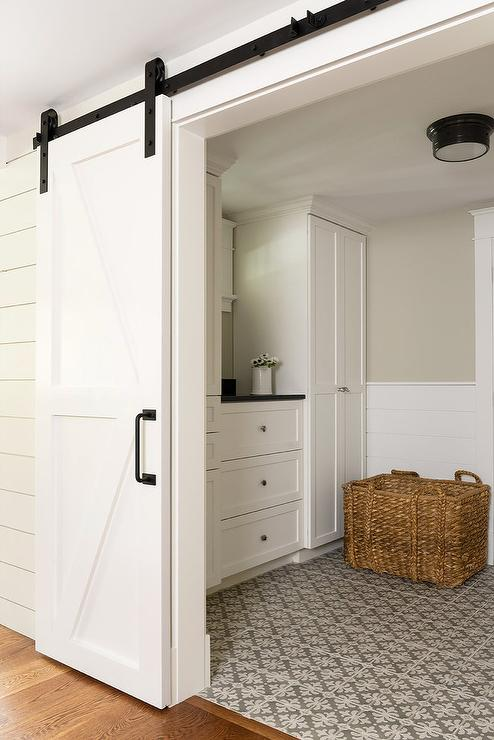 Laundry Room With White Barn Door On Rails Transitional