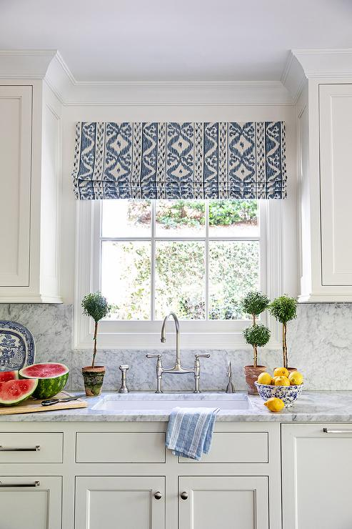 White and Blue Ikat Roman Shade on Window Over Sink ...