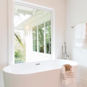 Modern Oval Bathtub On Marble Floor Tiles With Brass Inlays
