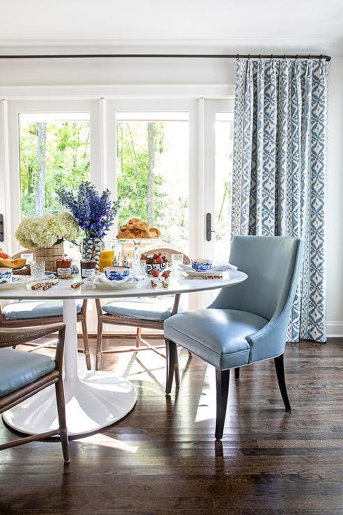 Blue Leather Chairs at Oval Marble Top Dining Table ...