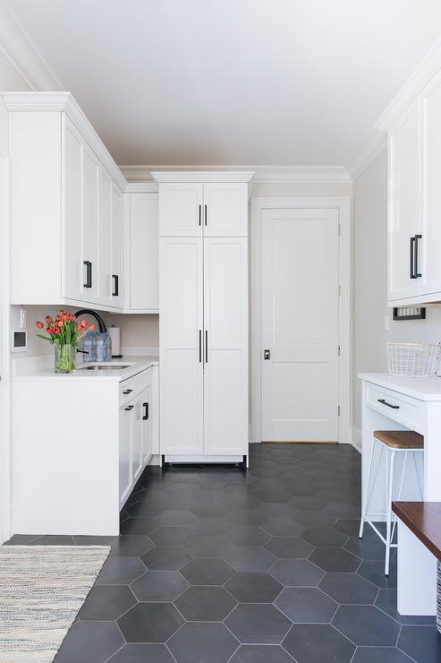 White Laundry Room Cabinets With Large Black Hexagon Floor Tiles Transitional Laundry Room