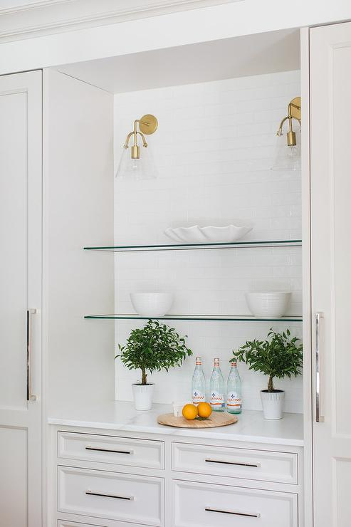 Stacked Glass Shelves Lining White Subway Tiled Kitchen ...