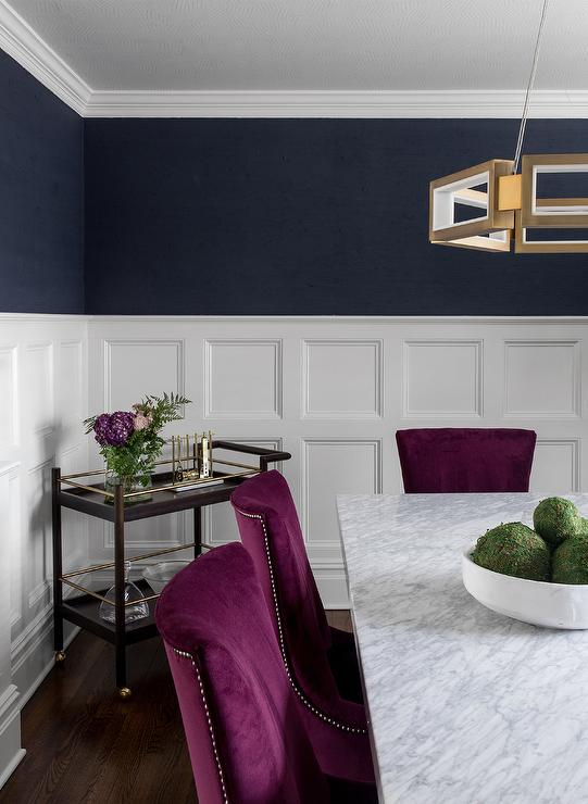 Stacked Wainscoting With Navy Blue Walls Contemporary Dining Room