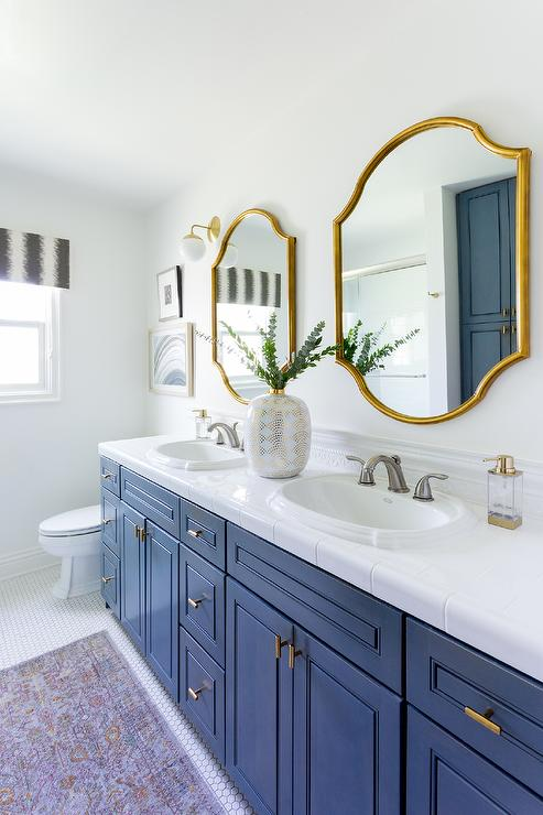 Brass Vanity Mirror With Brass Swing Arm Sconce