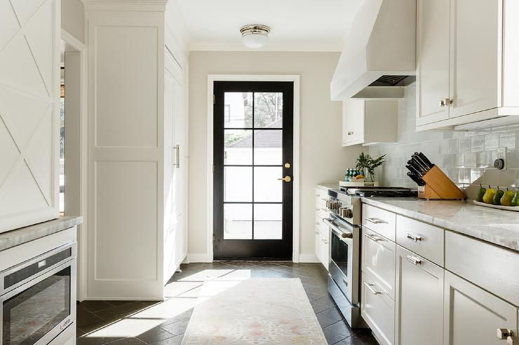 Black Herringbone Floor Tiles With White Cabinets Transitional