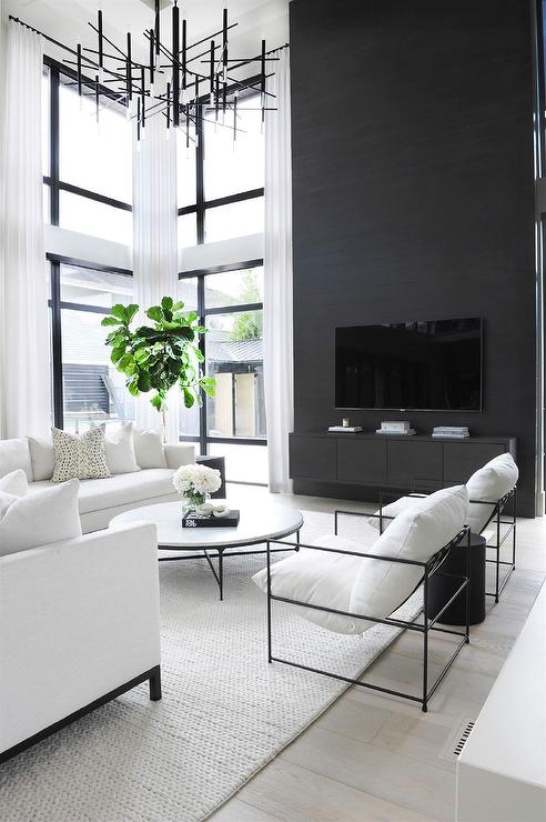 Two Story Black Accent Wall With Black Floating Tv Console Modern Living Room