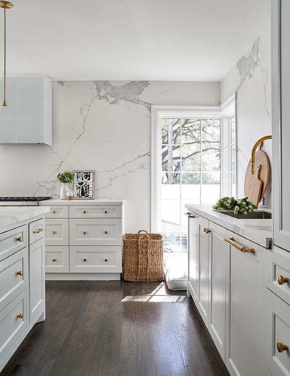 Modern White Kitchen with Marble Slab Clad Walls ...