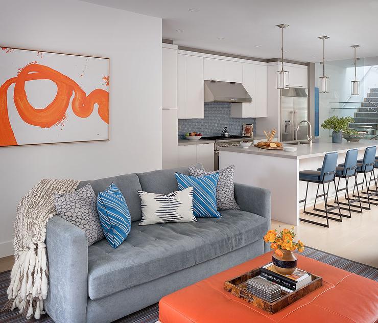 Wondrous Blue Tufted Sofa With Orange Ottoman Coffee Table Machost Co Dining Chair Design Ideas Machostcouk