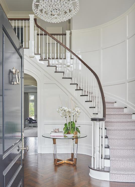 Round Brass And Lucite Accent Table At Curved Staircase