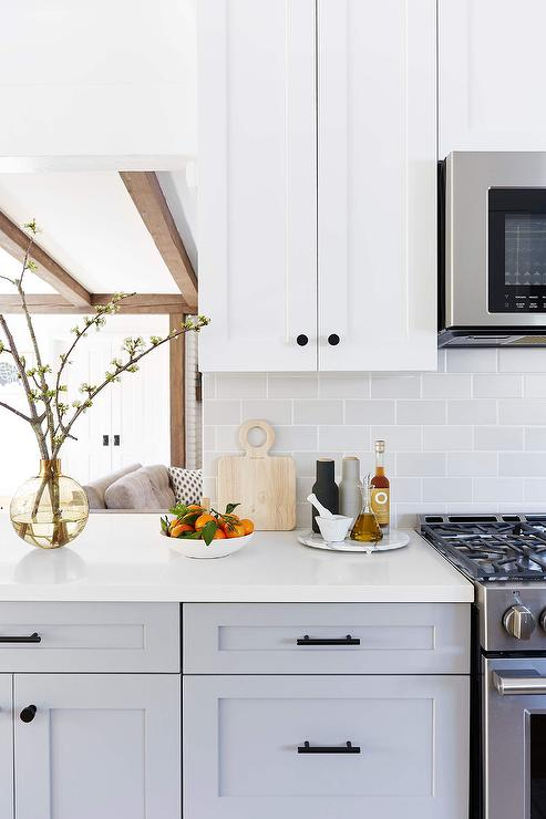 White Upper Cabinets With Light Gray Subway Tiles Transitional Kitchen