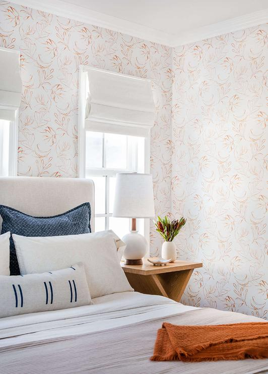 white and orange wallpaper with white linen bed