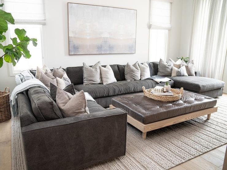 Black Leather Sectional With Brown Leather Tufted Ottoman Coffee