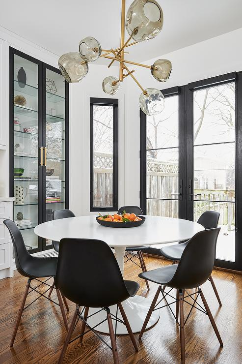 Awesome Eames Black Molded Plastic Chairs At White Tulip Table Spiritservingveterans Wood Chair Design Ideas Spiritservingveteransorg