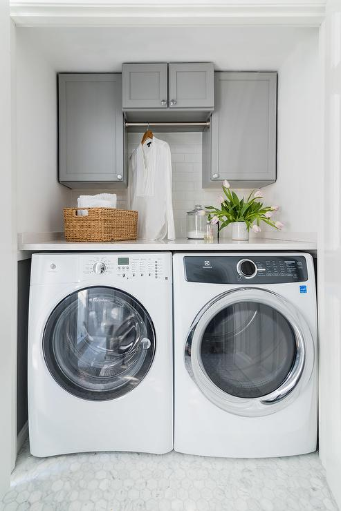 Gray Shaker Cabinets Over White Front Load Washer And Dryer