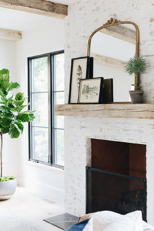 Painted White Brick Fireplace With Gold Mirror Transitional