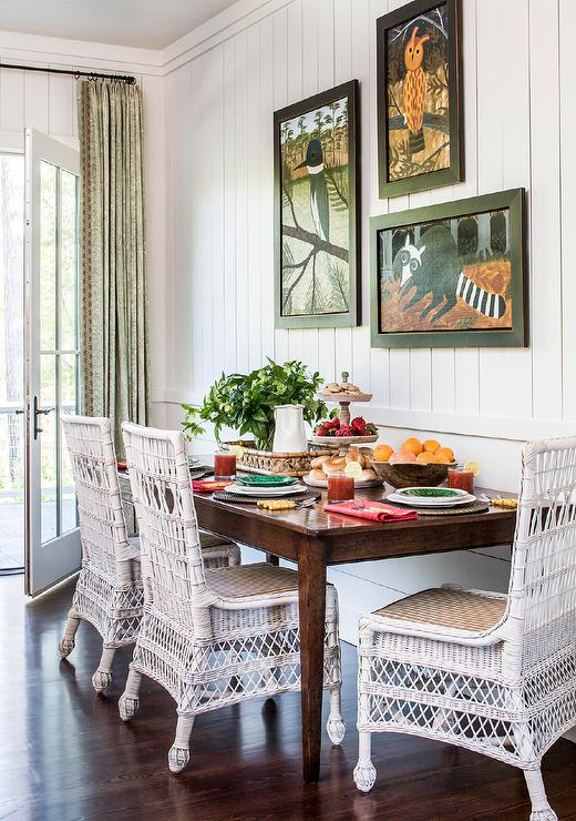 White Wicker Dining Chairs At Brown Wooden Table Cottage Dining Room