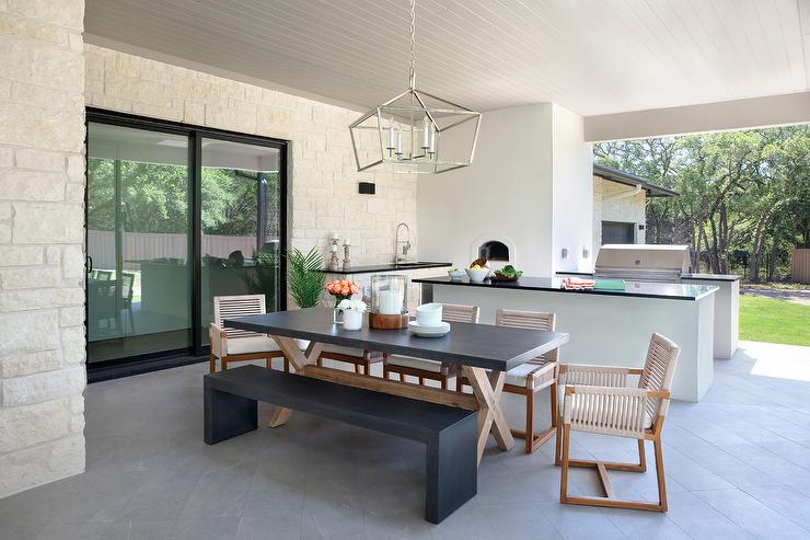 Concrete Top Outdoor X Base Dining Table With Light Gray Chairs Transitional Deck Patio