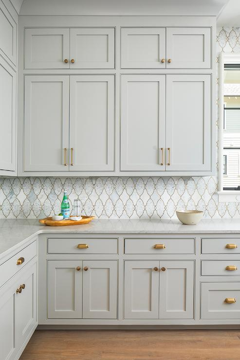 Stacked Light Gray Kitchen Cabinets With Marble Arabesque Tiles Transitional Kitchen