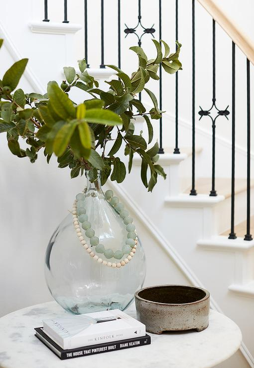 home goods decorative vases.htm recycled glass vase on round marble top accent table  recycled glass vase on round marble top