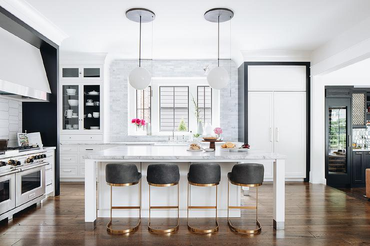 Gold And Black Stools At White Kitchen Island Transitional