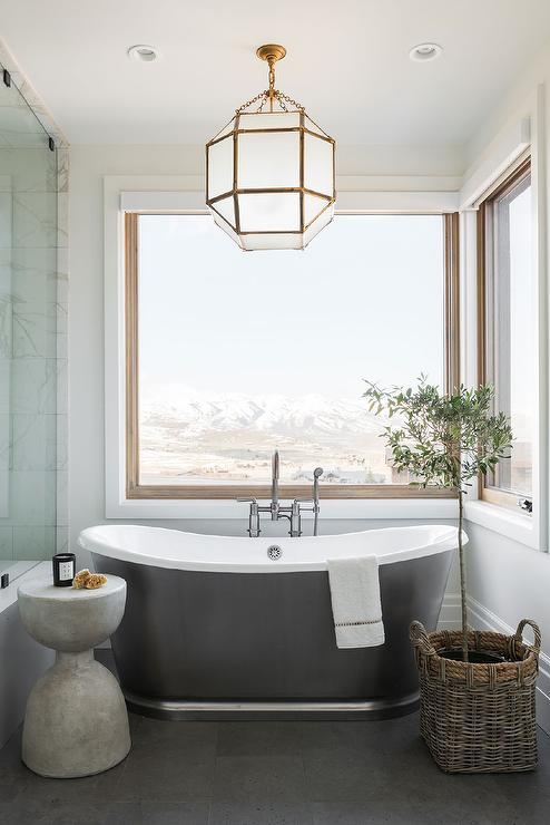 privacy for bathroom window over tub decorative window.htm glass and brass lantern over modern gray cast iron bathtub  modern gray cast iron bathtub