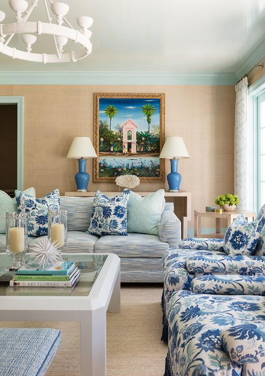 White And Blue Print Sofa With Aqua Blue Fretwork Pillows Contemporary Living Room