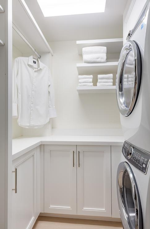 Small White Laundry Room With Stacked Washer And Dryer Transitional Laundry Room