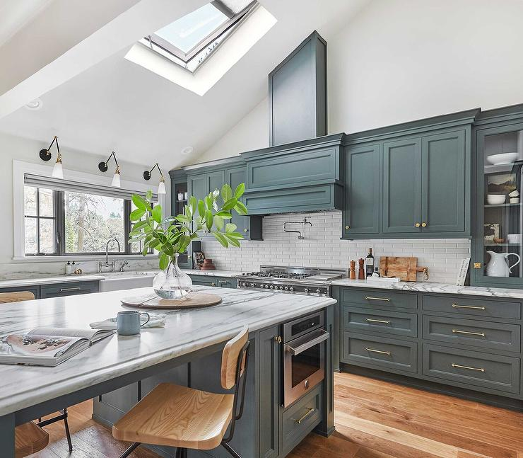 Hunter Green Kitchen Island With Black And White Marble Countertop Transitional