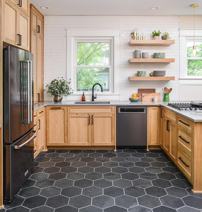 Black Hexagon Floor Tiles With Honey Stained Cabinetry Transitional Kitchen