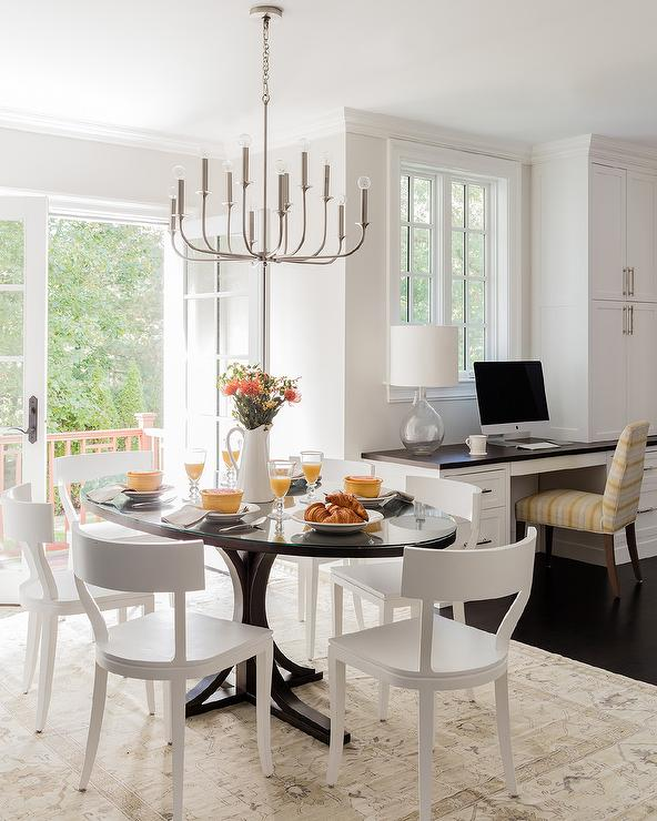 White Klismos Chairs At Oval Black Dining Table Transitional Dining Room